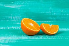 Orange fruit on color table background. Fresh orange fruit on color table background Royalty Free Stock Images