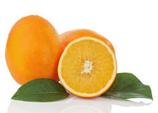 Fresh orange fruit with green leaves isolated on white backgroun Stock Images
