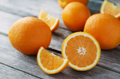Fresh orange fruit on grey wooden background. Royalty Free Stock Photos