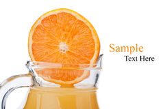 Fresh orange fruit and juice Stock Images