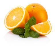 Fresh orange fruit with leaf mint isolated on white background. Fresh orange fruit with leaf mint isolated on a white background royalty free stock image