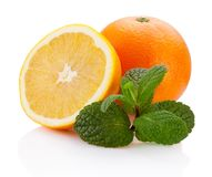 Fresh orange fruit with leaf mint  on white background Royalty Free Stock Photo
