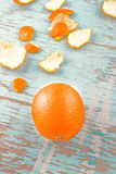 Fresh Orange Fruit and Peel on Rustic Wood Background Royalty Free Stock Photo