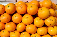 Fresh orange fruit symmetrically to attract buyers at market stall. Fresh orange fruit symmetrically to attract buyers at city market stall Stock Photography