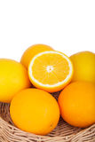 Fresh orange fruits in basket on wood Royalty Free Stock Photo