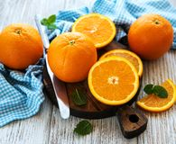 Fresh orange fruits. On a old white wooden table royalty free stock photo