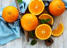 Fresh orange fruits. On a old white wooden table stock photography