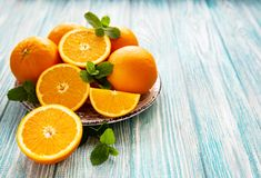 Fresh orange fruits. On a old wooden table stock images