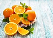 Fresh orange fruits. On a old wooden table stock photos