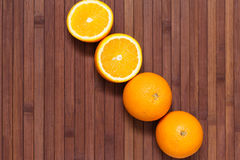 Fresh orange fruits isolated on wooden background. Healthy food. A mix of fresh fruit. Group of citrus fruits. Vegetarian raw fruit. Nutrition for a healthy Stock Images