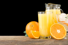Fresh orange fruits juice and on black Stock Image
