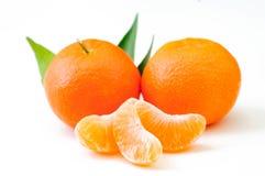 Fresh orange fruits with leaf isolated on white Royalty Free Stock Photo