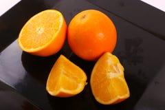 Fresh Orange fruits. On modern dish Stock Image
