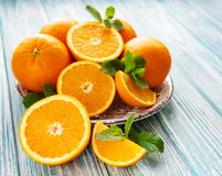 Fresh orange fruits. On a old wooden table royalty free stock photography