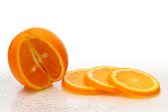 Fresh orange Fruits with slices Stock Photos
