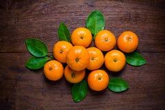 Fresh orange fruits on  table. Royalty Free Stock Photo