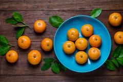 Fresh orange fruits on  table. Stock Photos