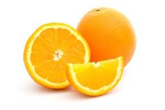 Fresh orange fruits on white background. Ripe orange and its half and slice on a white Stock Images
