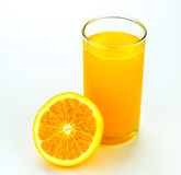 Fresh orange and glass with juice. Royalty Free Stock Image
