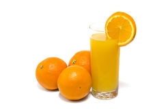 Fresh orange and glass of juice Stock Images
