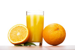 Fresh orange and glass with juice over white Royalty Free Stock Photo