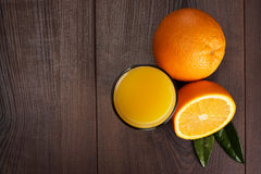 Fresh orange and glass with juice on the wooden Stock Photo