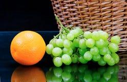 Fresh orange and grape Stock Photography
