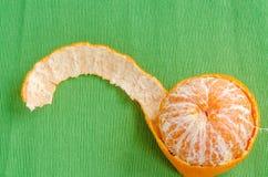Fresh orange on a green tablecloth background Stock Photos