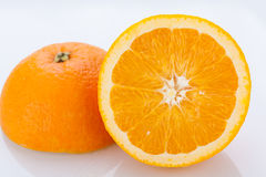 Fresh orange halved to show the pulp Stock Photos