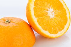 Fresh orange halved to show the pulp Stock Photo