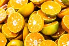 Fresh orange with orange halves on ice. At market Thailand royalty free stock photos