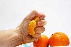 Fresh orange juice. Prepared by hand Stock Photography