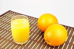 Fresh orange and juice Stock Photos