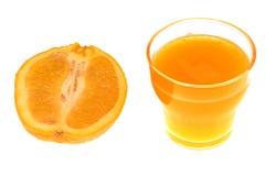 Fresh orange juice. And halved orange Royalty Free Stock Photos