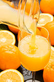 Fresh orange juice. Fresh and healthy orange juice poured in a glass Stock Images