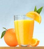 Fresh orange juice. A glass of orange juice and fresh oranges Stock Photo