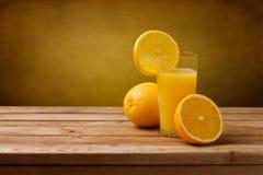 Fresh orange juice. On wooden table over grunge background Royalty Free Stock Image