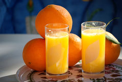 Fresh orange juice 3. Sill life composition with glass of fresh orange juice with oranges in a plate Stock Photo