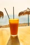 Fresh orange juice on the beach Stock Photography