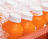 Fresh orange juice in the big ice bucket Stock Image