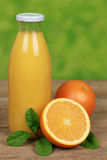 Fresh orange juice in a bottle Royalty Free Stock Photography