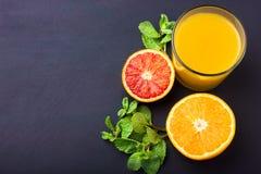 Fresh orange juice on dark background Royalty Free Stock Images