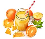 Fresh orange juice with fruit and green royalty free stock photography