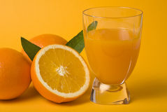 Fresh orange juice and fruits Royalty Free Stock Photos