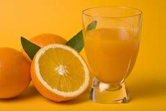 Fresh orange juice and fruits Royalty Free Stock Photos