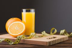 Fresh orange juice and fruits Stock Images
