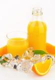 Fresh orange juice. Glass and bottle of fresh orange juice on white background Royalty Free Stock Images