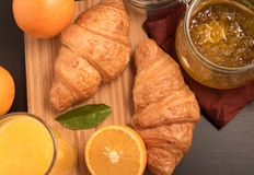Fresh orange juice in a glass with Croissant and jam Royalty Free Stock Image