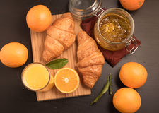 Fresh orange juice in a glass with Croissant and jam Stock Images