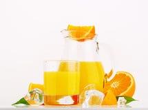 Fresh orange juice. Glass and jug of fresh orange juice on white background Stock Photography